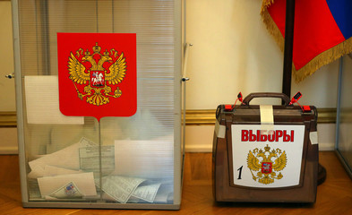 Ballot boxes are seen at a polling station inside the Russian Embassy, in London