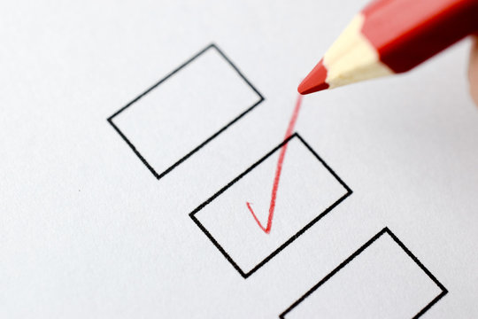 Marker puts a tick in the box on white paper