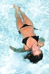 pretty beauty girl swimming in pool in resort hotel home
