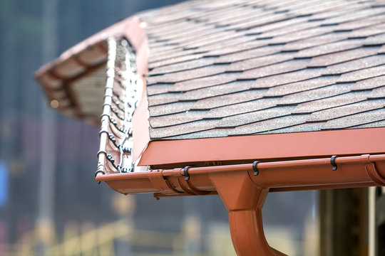 Detail image of new roof with gutter rain system