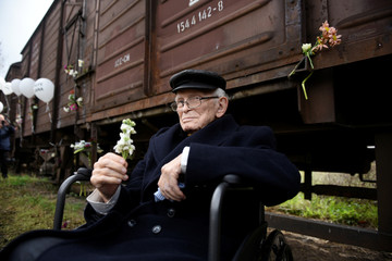 Moshe Haelion, a 93-year old Jewish survivor of the Holocaust, takes part in a memorial marking the 75th anniversary of the first deportation of Jews from Thessaloniki to Auschwitz, in Thessaloniki