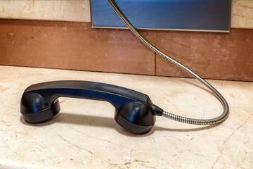 Telephone receiver in public phone cabin