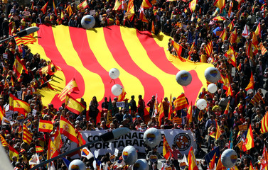 "People protest during a Spanish pro-unity demonstration held by ""Societat Civil Catalana"" platform in Barcelona"