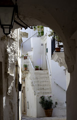 Beautiful street in whitewashed town Locorotondo, Apulia