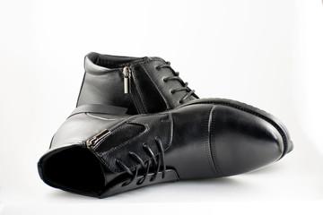 Black man's leather boots. Stylish black man's shoes.
