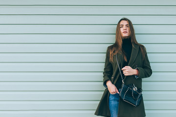 Attractive girl with long hair in a green coat Wall mural