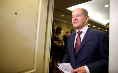 Germany's Finance Minister Olaf Scholz leaves a news conference during the 2018 G20 Conference in Buenos Aires