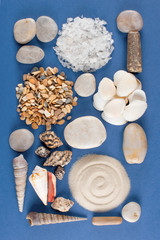 Abstract geometric pattern of various sea shells, sand and stones