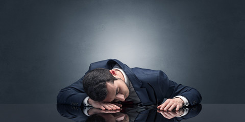 Businessman fell asleep at his workplace