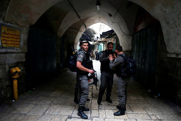 Israeli security forces stand at the site where an Israeli was wounded in a stabbing attack in Jerusalem's Old City, Israeli Police said