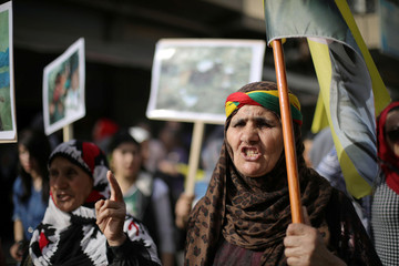 A Kurdish demonstrator protests against the deployment of Turkish forces in Afrin