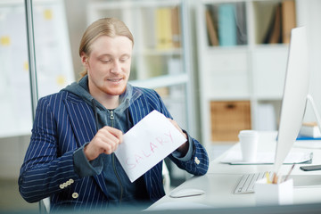 Businessman getting salary in envelope at office
