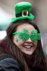 A spectator wears Irish themed glasses during the St Patrick's Day parade in London