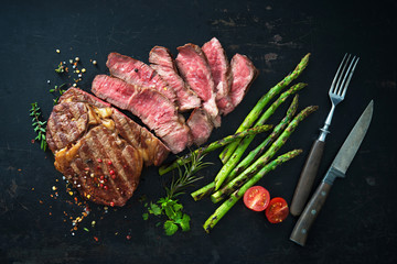 Roasted rib eye steak with green asparagus