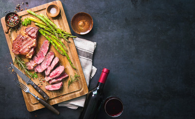 Garden Poster Steakhouse Roasted rib eye steak with green asparagus and wine