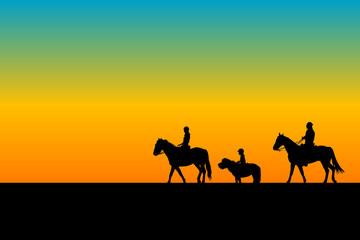 Family riding horses and ponny
