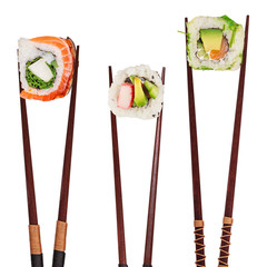Traditional japanese sushi pieces placed between chopsticks, separated on white background.