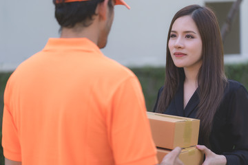 Office woman is receiving package from delivery man