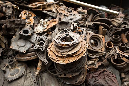 Dump of pieces of iron and wrecking machinery parts. Thailand, Bangkok, China Town.