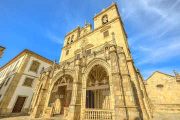 Braga, Portugal. Facade of Braga Cathedral with its gothic bell towers. Se de Braga is the oldest cathedral in Portugal, Europe. Braga urban cityscape.