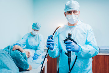 Endoscopy at the hospital. Doctor holding endoscope before gastroscopy