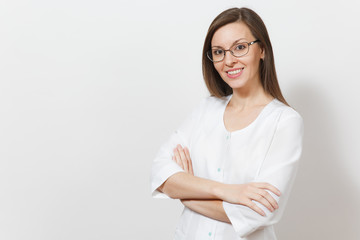 Smiling happy confident beautiful young doctor woman with glasses isolated on white background. Female doctor in medical uniform holding hands folded. Healthcare personnel, health, medicine concept.