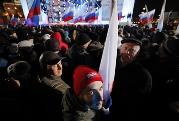 People attend a rally and concert marking the fourth anniversary of Russia's annexation of the Crimea region, at Manezhnaya Square in central Moscow