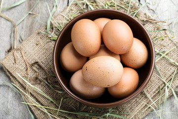 fresh eggs in clay plate