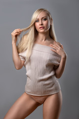 Woman in nude colored blouse and panties.