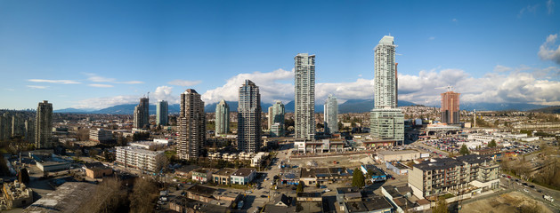 Burnaby, Greater Vancouver, British Columbia, Canada - March 3, 2018: Aerial panoramic view of Brentwood Mall and Residential Buildings.