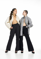 Two Topless girls posing on a white background.