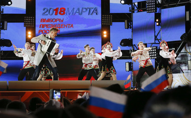 Artists perform during a rally and concert marking the fourth anniversary of Russia's annexation of the Crimea region, at Manezhnaya Square in central Moscow