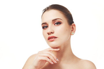 Beautiful young female with make up, poses nuse against white background, has mysterious expression, has healthy pure skin and attractive look. People, skin care, beauty and appearance concept