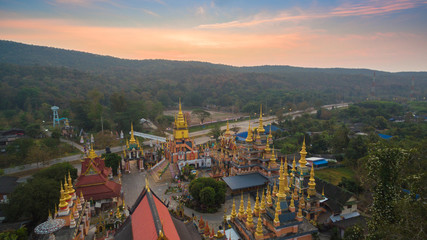 aerial photography sunrise at wat Huay Shrykhao hindu architecture in Chiang Rai Thailand