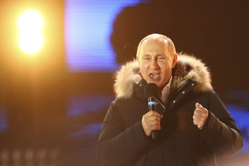 Russian President and Presidential candidate Putin delivers a speech during a rally and concert marking the fourth anniversary of Russia's annexation of the Crimea region, in Moscow