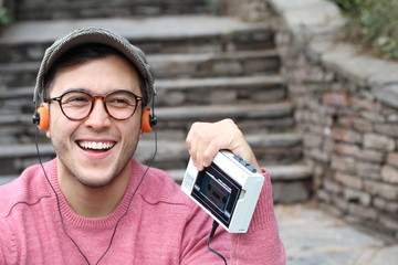 Ethnic male listening to a cassette
