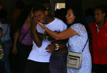 Relative of 1-year-old Benjamin reacts during his funeral in Rio de Janeiro