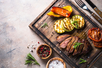 Aluminium Prints Grill / Barbecue Grilled beef steak and grilled vegetables