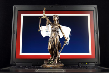 Symbol of law and justice with Wyoming State Flag on laptop. Studio shot.