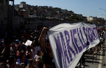 Demonstrators take part in a rally against the shooting of Rio de Janeiro city councilor Marielle Franco in Mare slums complex, which was her home community, in Rio de Janeiro
