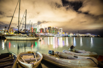 Wall Mural - Beautiful view of San Diego California at night after sunset with boats and lights of skyline in the background