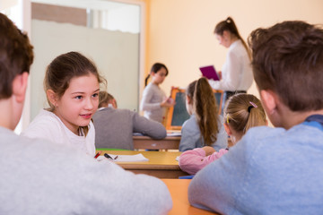Pupils chattering at lesson