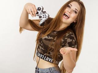 Gamer woman holding gaming pad