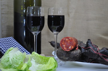 Glasses of red wine and classic Spanish sausages
