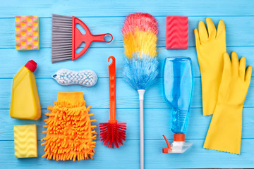 Cleaning stuff on blue wooden background. Set of cleaning products. Time for clean up.