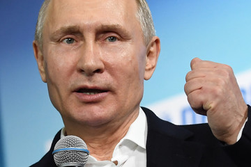 Russian President and Presidential candidate Putin speaks during a meeting with supporters at his campaign headquarters in Moscow