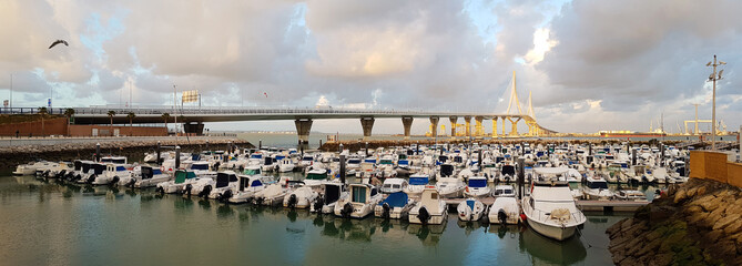 Hundreds of pleasure boats in the bay of Cadiz, next to the bridge of the Constitution of 1812, also called the bridge of La Pepa, on the coast of Andalusia, southern Spain