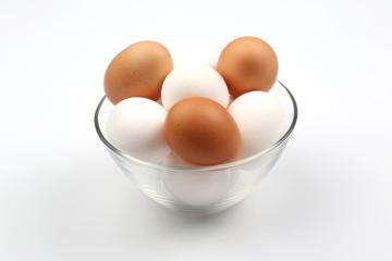 chicken eggs lie in plate on white background.