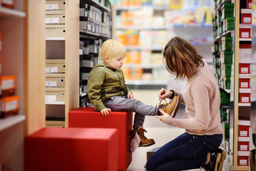 Cute little boy during shopping with his young mother