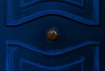 close up on a round door handle with decorative elements, door decoration